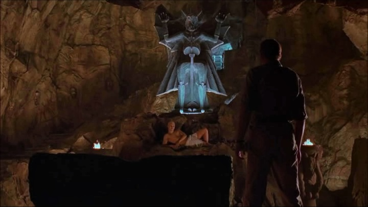 Merrin confronts the possessed Cheche, in Dominion: The Prequel to the Exorcist.